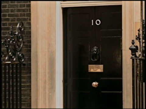 door of 10 downing street / tracking shot british prime minister tony blair exiting / london - only mature men stock videos & royalty-free footage