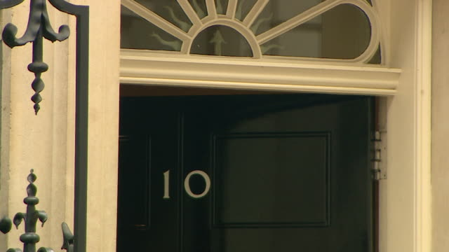 door of number ten downing street closing - downing street stock videos and b-roll footage