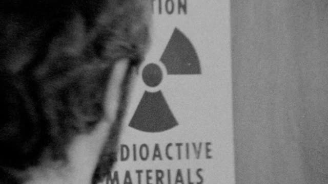 vídeos de stock, filmes e b-roll de door open with radioactive material sign visible / patient is led to table for ct imaging / radioactive materials on november 01 1989 in los angeles... - tomografia