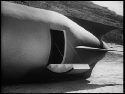 b/w 1952 door opening on spaceship in desert man in helmet + jet pack exiting - actor stock videos and b-roll footage
