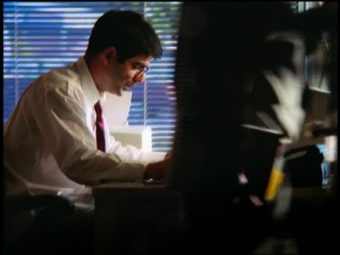 ms profile door opening to reveal frustrated businessman at computer / he breaks pencil in half - broken pencil stock videos & royalty-free footage