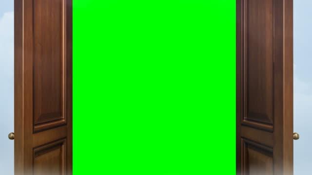 hd: door opening with chroma key - glowing doorway stock videos & royalty-free footage