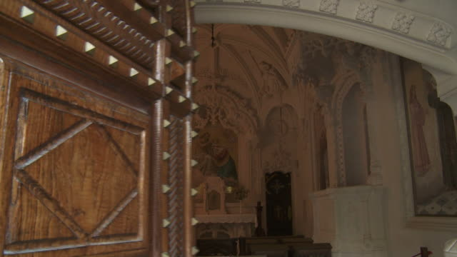 A door opens revealing an beautiful chapel within the Quinta da Regaleira in Sintra, Spain.