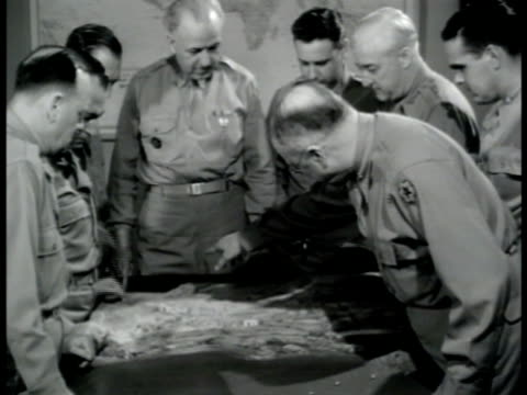 door sign plans division staff officers standing around tabletop topographic model looking talking - 1943 stock videos and b-roll footage