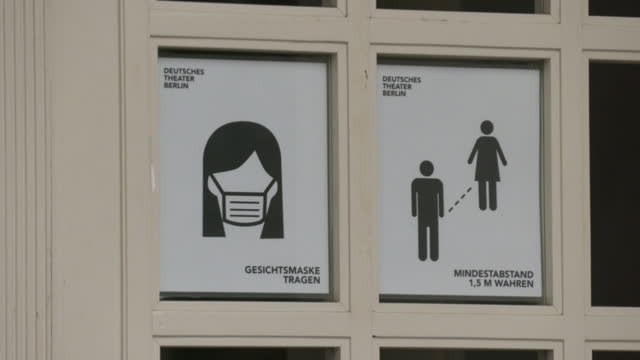 door with notice for covid-19 prevention, berlin, germany - poster stock videos & royalty-free footage