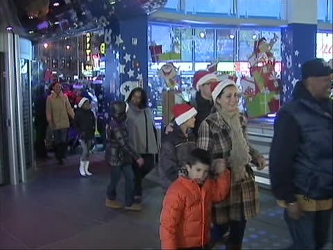 doors open and shoppers going into times square new york city toys r us on black friday, some people wearing santa hats and cheering you can tell... - toys r us stock videos & royalty-free footage
