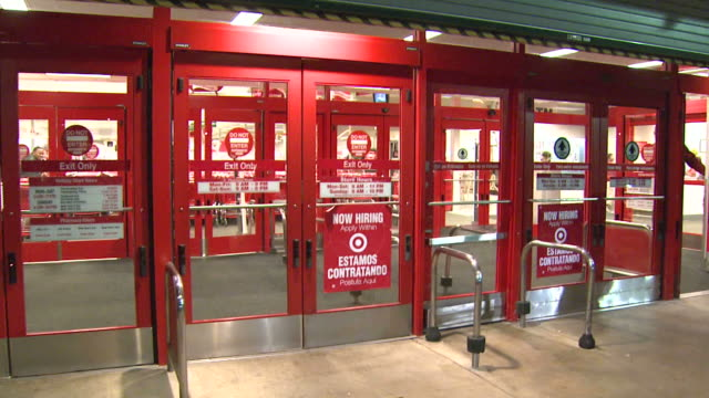 doors opening at target for black friday shopping and waiting customers streaming inside / united states - black friday stock videos & royalty-free footage