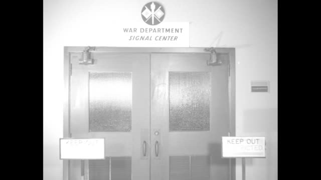 ms doors with sign above with insignia and reading war department signal center sign by door reading keep out restricted officer enters and turns... - womens army corps stock videos & royalty-free footage