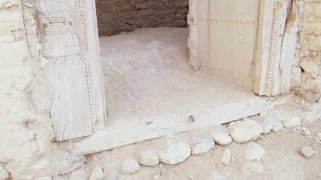ms tu doorway of ruined mud house, muscat, oman - adobe bildbanksvideor och videomaterial från bakom kulisserna