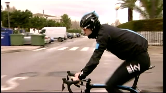 eufemiano fuentes trial fight to save evidence england ext sir bradley wiggins along road on bike wearing cycling gear and sky motif on tracksuit... - tracksuit bottoms stock videos & royalty-free footage