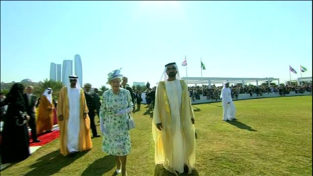 doping scandal at godolphin stables; lib / united arab emirates: abu dhabi: sheikh mohammed bin rashid al maktoum and queen elizabeth ii along end lib - シャイフ点の映像素材/bロール