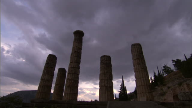 doric columns made of stacked stones encircle the temple of apollo at delphi. - doric stock videos & royalty-free footage