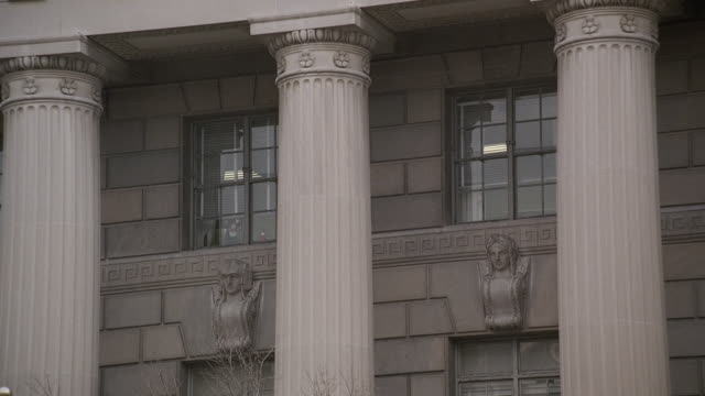 cu doric columns on the herbert c. hoover building, and the windows and sculptures behind / washington, d.c, united states - doric stock videos & royalty-free footage