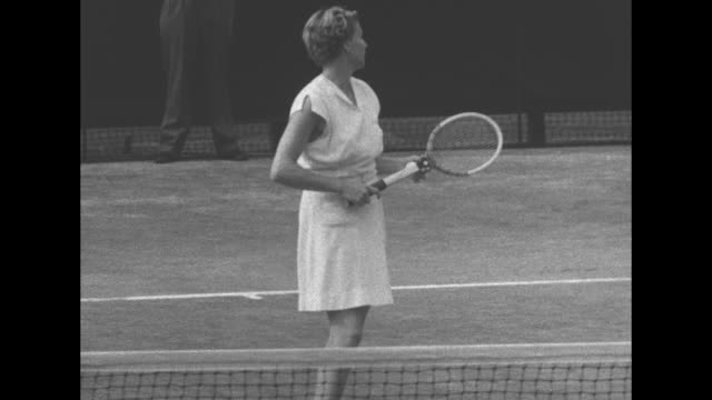 doris hart serves ball at wimbledon for the 1951 doubles final while partner, shirley fry irvin, waits ball to return, hart returns ball twice, hart... - game show stock videos & royalty-free footage