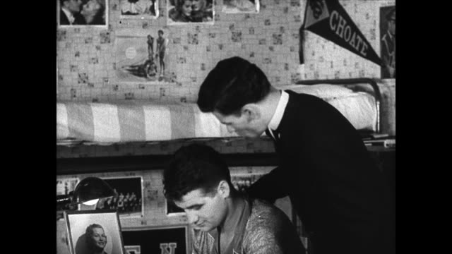stockvideo's en b-roll-footage met dorm sign: quiet please athletes trying to study. student tutoring athlete. athlete reading while brushing teeth. dramatization: students going out... - 1936