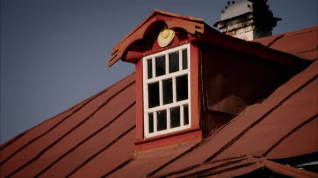 a dormer window adorns a high gable on the roof of a russian home. available in hd. - gable stock videos & royalty-free footage