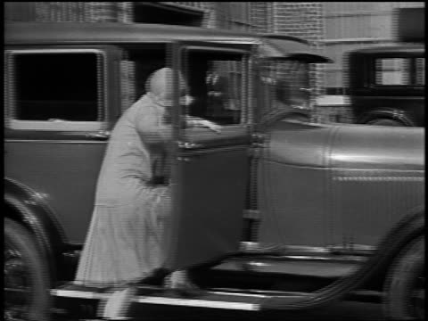 dorothy gish getting into car + waving to camera / newsreel - 1928 stock videos & royalty-free footage