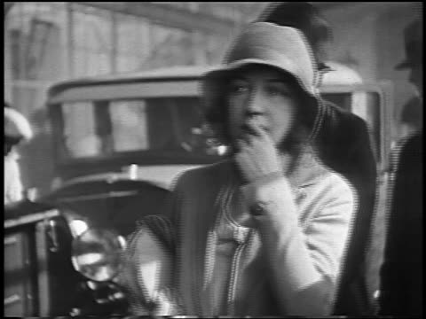 vídeos y material grabado en eventos de stock de dorothy gish in hat biting finger + shaking head / newsreel - 1928