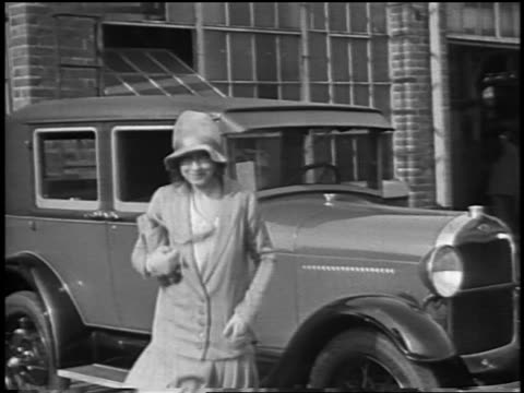 dorothy gish walking towards camera from car / newsreel - 1928 stock videos & royalty-free footage