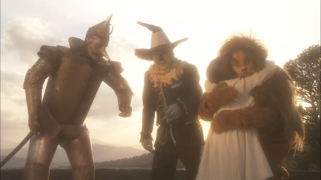 dorothy hugs tin-man, scarecrow, and lion goodbye. - performance stock videos & royalty-free footage