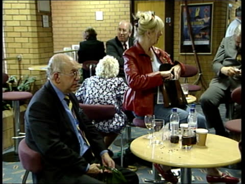 dorset bournemouth michael howard mp onto stage to applause at party conference pan tgv audience clapping and then sitting down ms howard settling... - asking stock videos & royalty-free footage