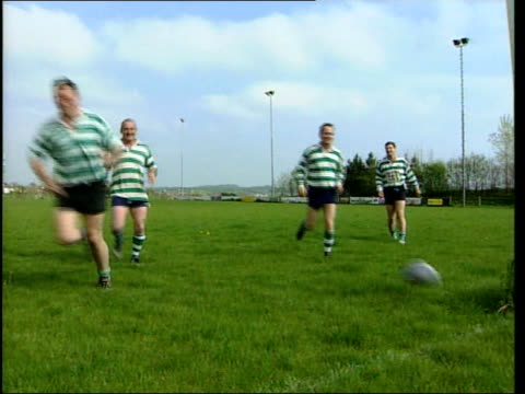 Dorset Dorchester Rugby players of the Dorchester Gladiators jogging along pitch and passing ball PAN Player coughing
