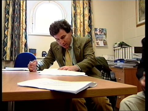 Tactical Voting ENGLAND Dorset Oliver Letwin MP sitting at meeting with colleagues LMS Letwin at meeting EXT Oliver Letwin MP interview SOT there are...