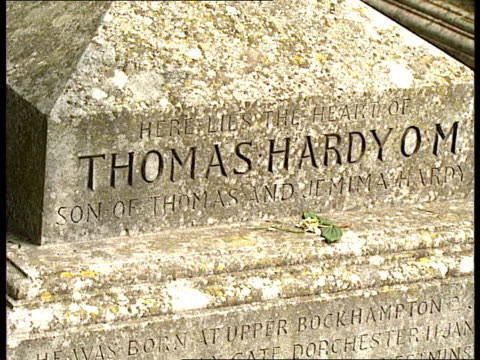 thomas hardy anniv festivities dispute stinsford cu flower pull out to gv stinsford church and graveyard / ts gravestone zoom in to carving on stone... - headdress stock videos and b-roll footage