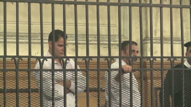 dos policias egipcios fueron condenados el lunes a diez anos de prision por la muerte del bloguero jaled said en 2010 icono de la revuelta que... - prisoner icon stock videos & royalty-free footage