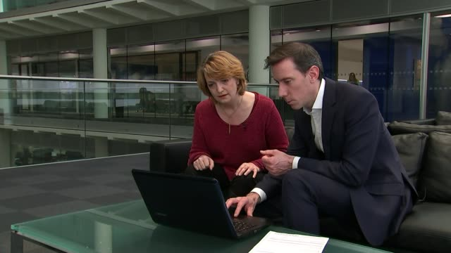 talk talk data breach indian call centre staff arrested t04121508 / 4122015 reporter sat with tamsin collison and looking at laptop computer... - data breach stock videos and b-roll footage