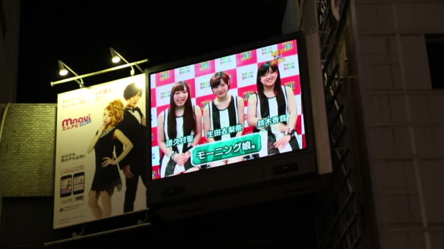 dotonbori is a canal in osaka where the outdoor advertisements and the neon lights are decorated on both banks to make tourists and citizens love to... - lightbox stock videos & royalty-free footage
