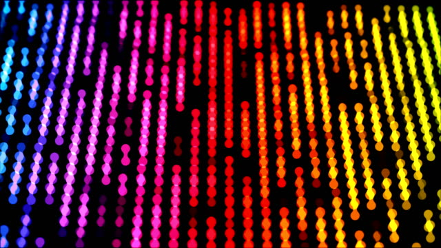 dots moving down in a row, abstract colorful composition closeup view, loop able 4k horizontal video background - fame stock videos & royalty-free footage