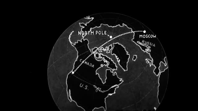 A dotted line moves on a map showing the transpolar route of Soviet flight crew Valery Chkalov Alexander Belyakov and Georgy Baydukov they were...