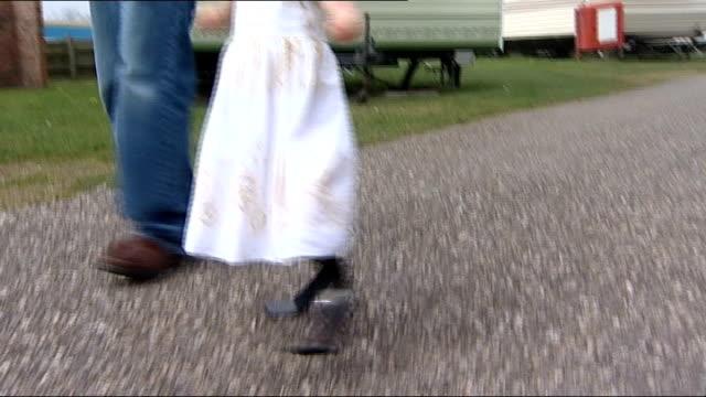 Double amputee Ellie Challis learns to walk using carbonfibre blades ENGLAND Essex Little Clacton EXT Ellie Challis walking wearing flexible...