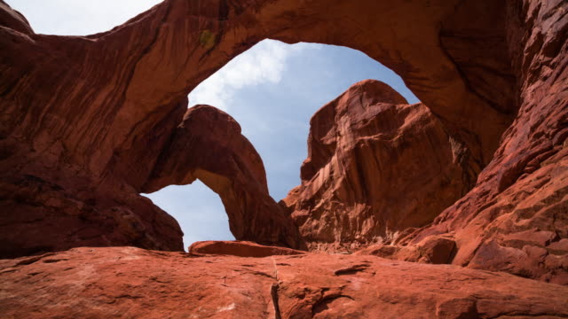 crane: double arch at arches national park - arch architectural feature stock videos and b-roll footage