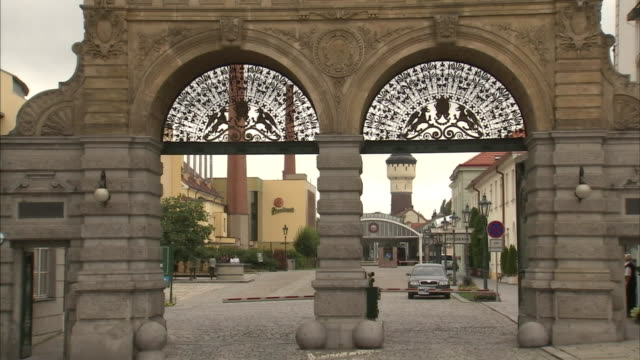 a double archway leads towards the pilsner urquell brewery. - pilsner stock videos & royalty-free footage