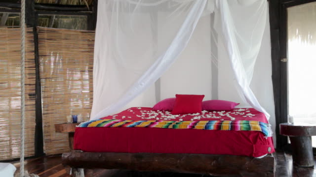 double bed in beach hut with mosquito net blowing in wind - double bed stock videos & royalty-free footage