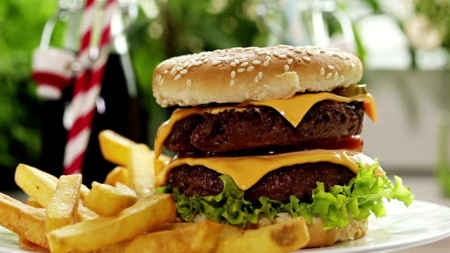 double burger and fries - cheeseburger stock videos & royalty-free footage