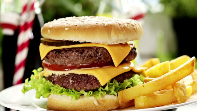 double burger and fries - hamburger stock videos & royalty-free footage