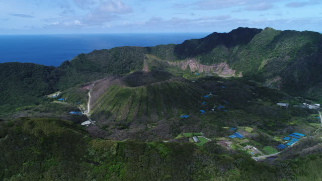 double caldera volcanic island - inside the crater - 2 - 残骸点の映像素材/bロール