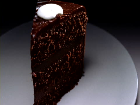 Double Cream Poured over a Large Slice of Chocolate Cake