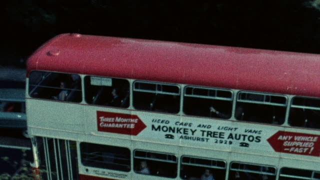 1974 montage double decker bus driving in / southampton, hampshire, england - hampshire england stock videos and b-roll footage