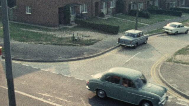 1974 zi double decker bus driving in traffic / southampton, hampshire, england - 英国ハンプシャー点の映像素材/bロール