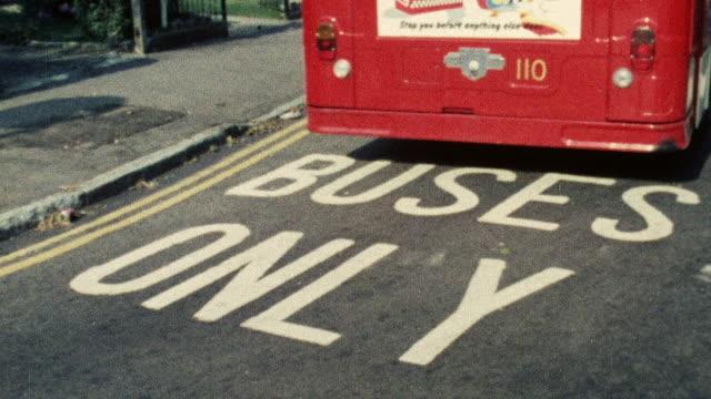 1974 montage double decker bus driving in traffic / southampton, hampshire, england - 英国ハンプシャー点の映像素材/bロール