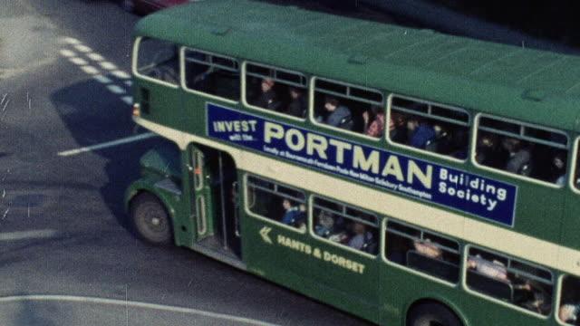 1974 ha double decker bus driving on busy street / southampton, hampshire, england - 英国ハンプシャー点の映像素材/bロール