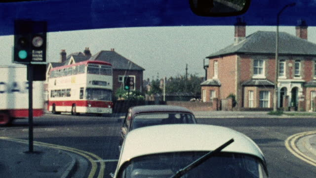 1974 montage double decker bus halted at a traffic light and driving on once it changed / southampton, hampshire, england - 1974 stock videos & royalty-free footage