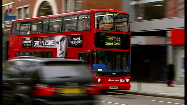 double decker bus with advert for 'green zone' film on side another bus with 'green zone' advertising along joe utichi interview sot - damon green stock videos and b-roll footage