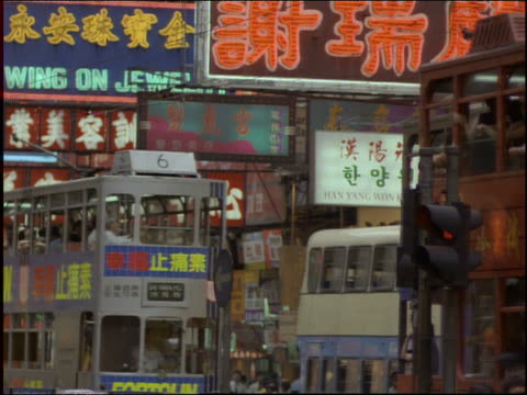 double decker buses on crowded city street / hong kong - 1997 stock-videos und b-roll-filmmaterial