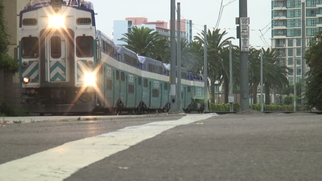 (hd1080i) double decker commuter train crosses - san diego stock videos & royalty-free footage