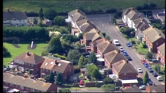 'Double dip' recession fears house prices and high street spending falls EXT AIR VIEW / AERIAL semi detached houses on housing estate